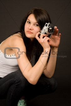 Attractive fashion girl with camera