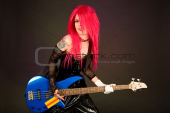 Attractive girl playing bass guitar