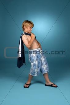 Boy in baggy blue plaid shorts