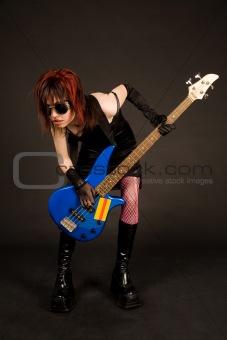 Strange musician with bass guitar