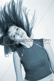 Beautiful girl shaking her hair, monochrome