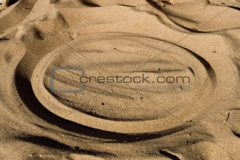 Cirlce in beach sand.