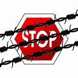 Barbed wire over stop sign