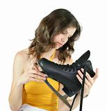 isolated girl looking at new black skates