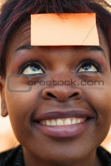 African American woman with post it sticky note