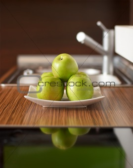 Green apples on kitchen table