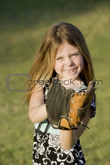 Cute young girl with a baseball