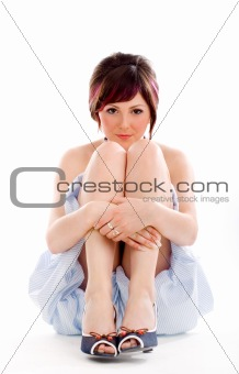 Sitting young sensual woman
