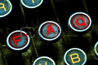 close up on typewriter faq keys