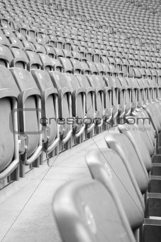 Rows of grey empty stadium seats