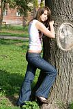The beauty girl standing near a tree 2