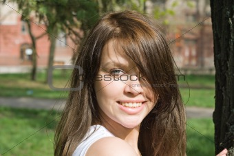 Portrait of the smiling beauty girl outdoor