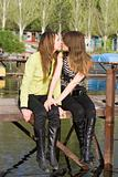 Two beautiful kissing girls on a mooring 2