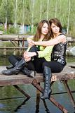Two beautiful embracing girls on a mooring 2