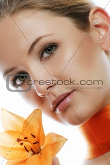 fashion and beauty portrait with a flower