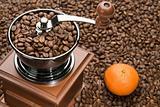 Old coffee grinder and Orange