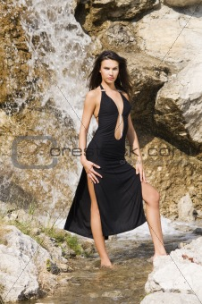 waterfall and black dress