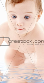 portrait of crawling baby boy