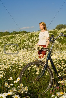 Woman on the hill covered with daisies