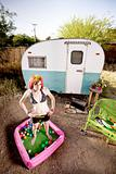 Woman outside a trailer