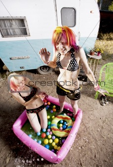 Women Splashing in a Play Pool