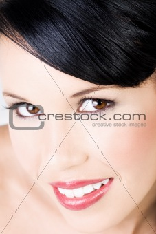Young beautiful female with gentle smile