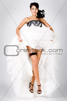 Excited young beautiful bride jumping