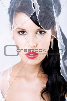 Happy young bride with veil looking and red lips