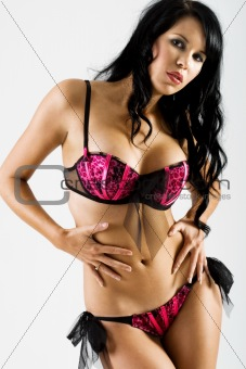 Slim female in black and pink lingerie