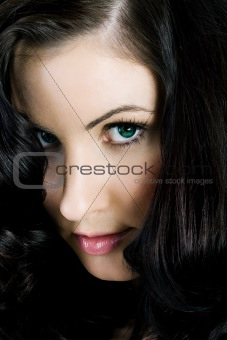 Portrait of a mysterious female with huge hair