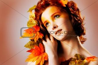 Autumn portrait of a beautiful female