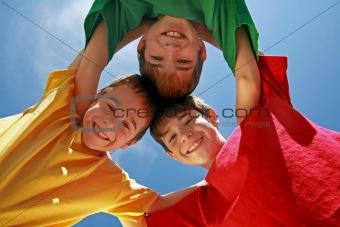Three Boys Huddling