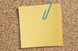 Yellow paper note with clip.
