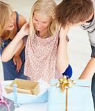 Friends looking at gifts