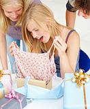 Young girl opening birthday present