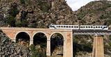 Train on the bridge through a precipice, Corsica
