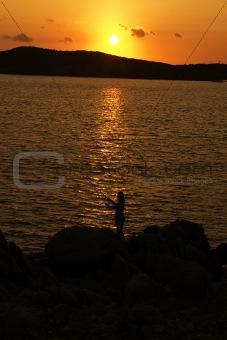 Fishing on soft sunset on Sardinia