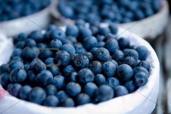 Close-up image of blueberries inside a basket
