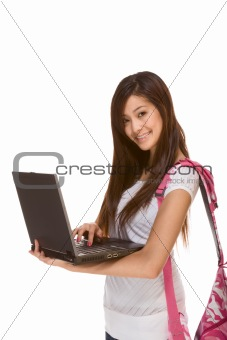 Asian student in jeans with backpack, laptop