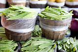 Baskets overflowing with fresh snap peas