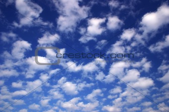 Blue sky with fluffy white clouds