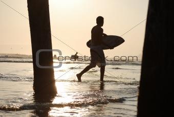 Skim Boarders Through the Pier