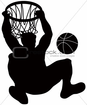 Basketball player hanging on to the hoop after dunking ball