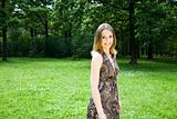 Beautiful Woman Walking On The Park