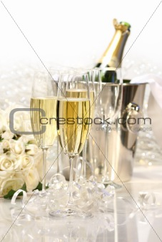 Champagne and a bouquet of roses