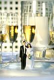 Wedding cake figurines on dinner plate