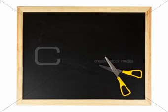 Chalkboard with yellow scissors