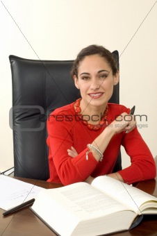Attractive brunette businesswoman in red