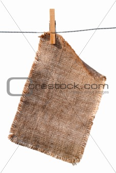 burlap canvas with lacerate edges hanging with wooden peg