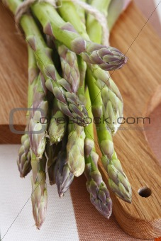 Green asparagus on a wooden board